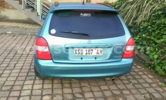 Buy Used Mazda Familia Black Car in Manzini in Swaziland