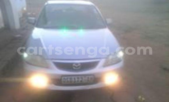 Buy Used Mazda 323 White Car in Manzini in Swaziland