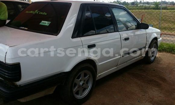Buy Used Mazda 323 White Car in Manzini in Swaziland
