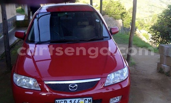 Buy Used Mazda Familia Red Car in Manzini in Swaziland