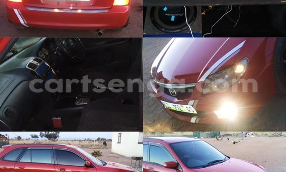 Buy Mazda Familia Red Car in Manzini in Swaziland