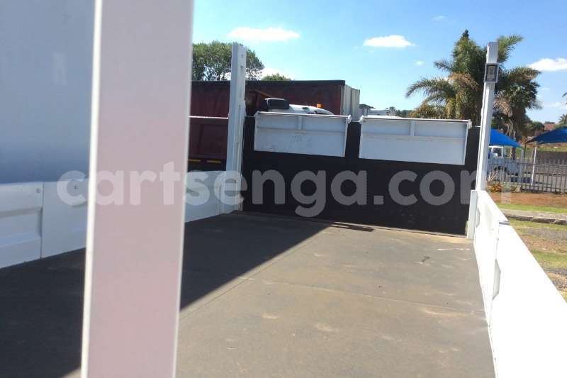 Big with watermark nissan truck dropside ud40 dropside with tail lift 2012 id 60613702 type main