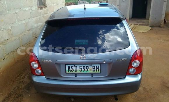 Buy Used Mazda Familia Silver Car in Manzini in Swaziland