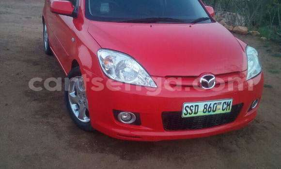 Buy Used Mazda Demio Red Car in Manzini in Swaziland