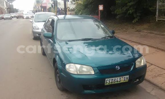 Buy Used Mazda Familia Green Car in Manzini in Swaziland