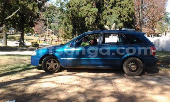 Buy Used Mazda Familia Blue Car in Mbabane in Swaziland